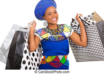pretty south african woman carrying shopping bags isolated on white