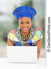 south african woman using laptop computer