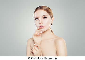 Pretty spa girl portrait. Facial treatment, skin care and cosmetology concept.