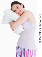 Pretty standing woman relaxing on her comfortable pillow