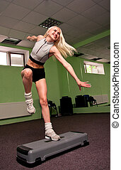 Pretty step aerobics girl