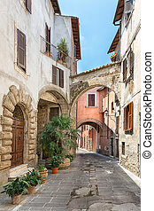 Pretty street in the ancient city of Tuscany - View of a...