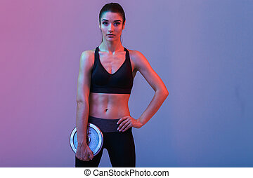 Pretty strong young sports woman make exercises
