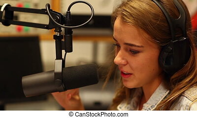 Pretty student presenting a radio show in college