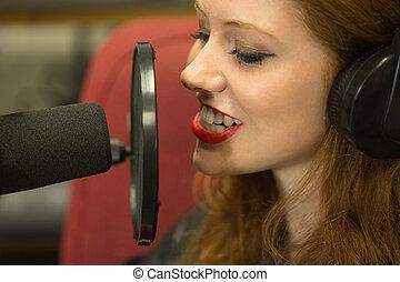 Pretty student presenting a radio show