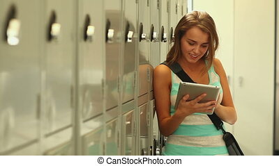 Pretty student using her tablet