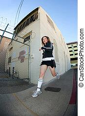 Pretty, stylish jogger run in the city