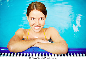 Pretty swimmer - Image of young smiling at camera in...
