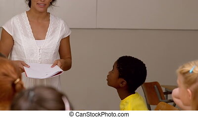 Pretty teacher talking to the pupil