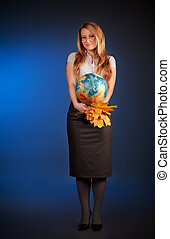 pretty teacher with globe and maple leaves