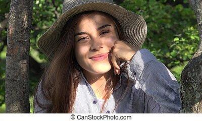 Pretty Teen Girl At Park