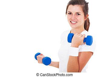 teen girl exercising with dumbbells