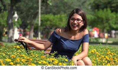 Pretty Teen Girl In Park With Braces And Eyeglasses