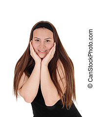 Pretty teen girl standing with booths hands on face