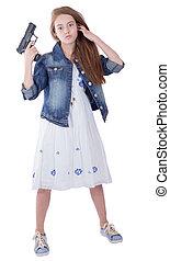 Pretty teen girl with a gun