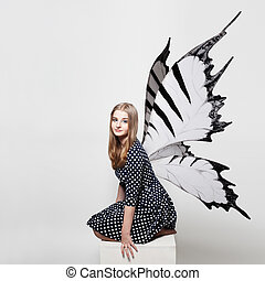 Pretty Teen Girl with Butterfly Wings