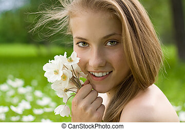 pretty teen girl with white bouquet near the face