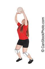 Pretty teenage girl playing volley ball