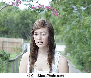 Pretty Teenaged Girl Looking Sad
