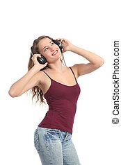 Pretty teenager girl dancing and listening to the music