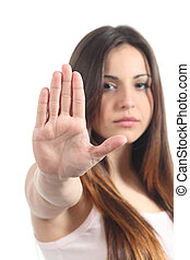 Pretty teenager girl making stop gesture with her hand ...
