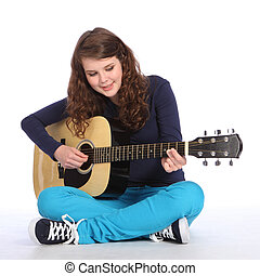Pretty teenager girl music on acoustic guitar
