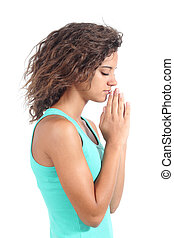 Pretty teenager girl praying isolated on a white background...