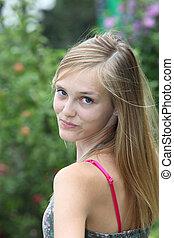 Pretty teenager looking back over her shoulder