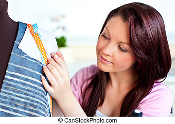 pretty teenager sewing using dummy - pretty woman sewing...