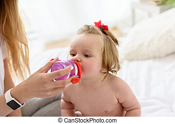 Pretty toddler is very thirsty
