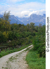 Pretty trail in the countryside of Dolomites Italy