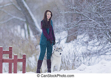 Pretty Tranquil Caucasian Brunette With Her Husky Dog during...