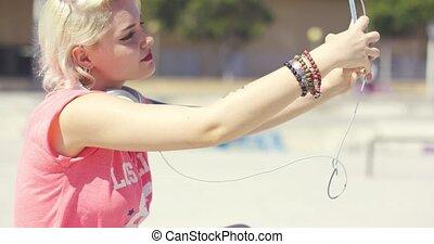 Pretty trendy young woman taking a selfie - Pretty trendy...
