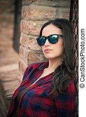 pretty urban girl portrait with sunglasses in the city