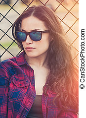 pretty urban young woman portrait with sunglasses