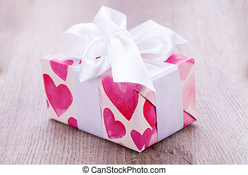 Pretty Valentines gift with hearts on the giftwrap on a big...