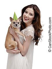 Pretty volunteer congratulates a dog - Pretty volunteer...