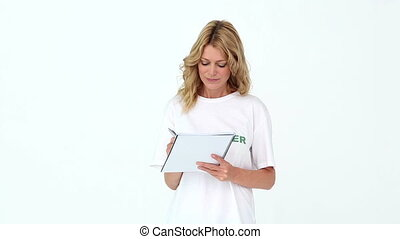 Pretty volunteer writing on notepad on white background