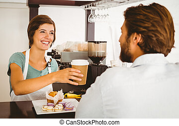 Pretty waitress serving happy customer