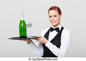 pretty waitress  with champagne and glass
