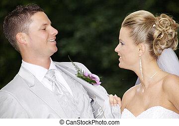 pretty wedding couple in park
