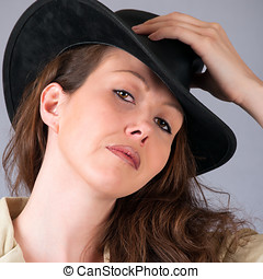 Pretty western woman with a cowboy hat