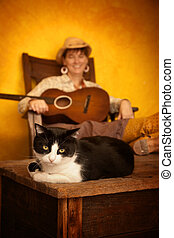 Pretty Western Woman with Guitar and cat