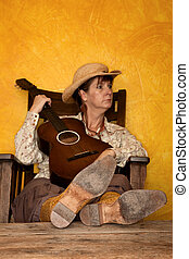 Pretty Western Woman with Guitar