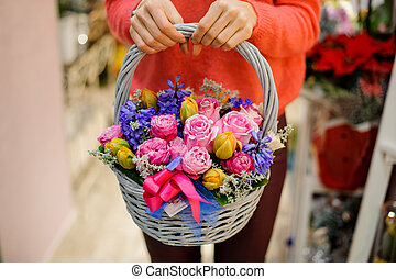 Pretty wicker basket with beautiful flower composition