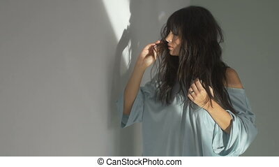 Pretty woman adjusting hair - Young attractive woman...