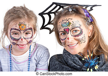 Pretty woman and her daughter in Halloween makeup