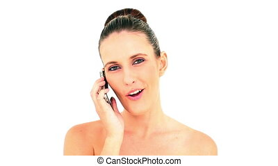 Pretty woman answering her smartphone on white background