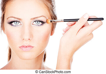 woman applying make up with brush