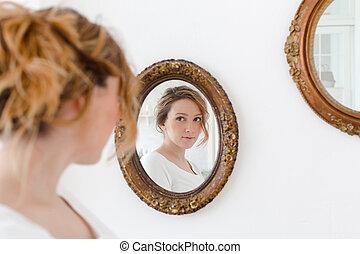 Pretty woman at mirror